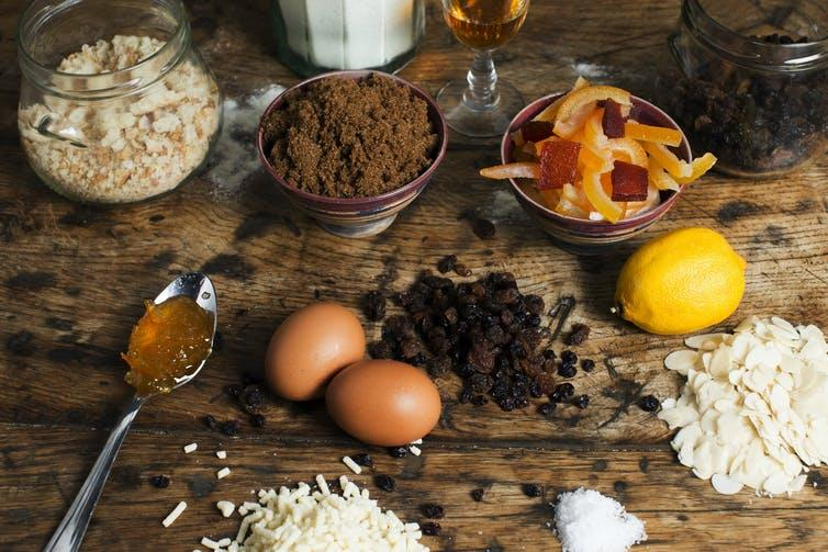 Christmas pudding ingredients on an old wooden table