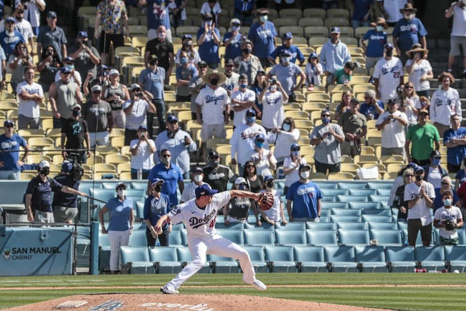 Dodgers reliever Corey Knebel delivers the final pitch of the game as he saves a 1-0 win over the Nationals on April 9.