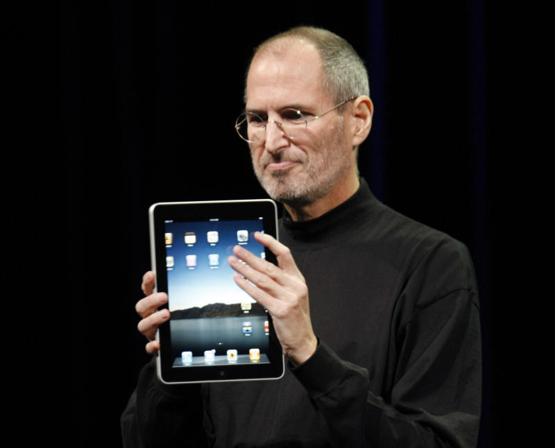 FILE - In this Jan. 27, 2010 file photo, Apple CEO Steve Jobs shows off the new iPad during an event in San Francisco. Imagine the potential treasures inside the stolen iPad of the late Steve Jobs, secret corporate documents, personal correspondence and maybe even game prototypes. Professional entertainer Kenny the Clown, who unwittingly received the stolen tablet after the Apple co-founder's Palo Alto home was burglarized last month, says he never examined the touch-screen device's contents.  The San Jose Mercury News says Kenny the Clown, whose real name is Kenneth Kahn, had no idea the iPad came from the Jobs residence until a friend who gave it to him was charged with burglary and police had confiscated the device. Authorities say 35-year-old Kariem McFarlin stole iPods, Macs, jewelry and Jobs' wallet. He is due in court Monday and recently hired a lawyer.  (AP Photo/Paul Sakuma, File)