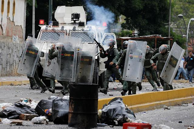 <p>Venezuelan National guards fire tear gas toward opposition supporters during a protest against Venezuela's President Nicolas Maduro's government in Caracas, Venezuela May 2, 2017. (Photo: Carlos Garcia Rawlins/Reuters) </p>