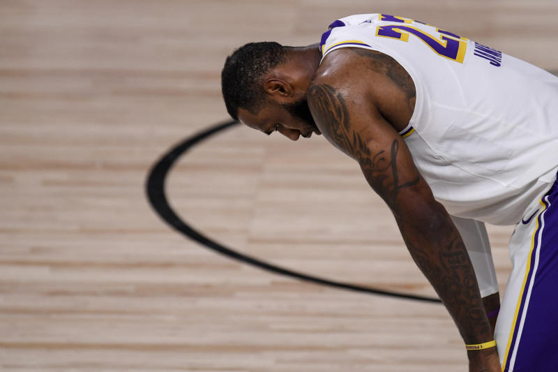 LeBron James (23) of the Los Angeles Lakers takes a breather against the Denver Nuggets during the fourth quarter of Denver's 114-106 win