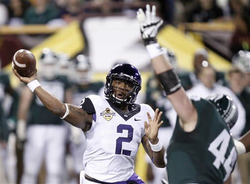 TCU quarterback Trevone Boykin, left, passes under pressure from Michigan State defensive end Marcus Rush, right, during the first half of the Buffalo Wild Wings Bowl NCAA college football game Saturday, Dec. 29, 2012, in Tempe, Ariz. (AP Photo/Paul Connors)