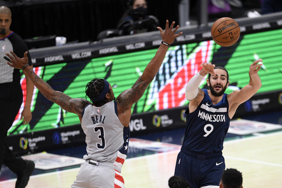 Minnesota Timberwolves guard Ricky Rubio (9) passes against Washington Wizards guard Bradley Beal (3) during the second half of an NBA basketball game, Saturday, Feb. 27, 2021, in Washington. (AP Photo/Nick Wass)