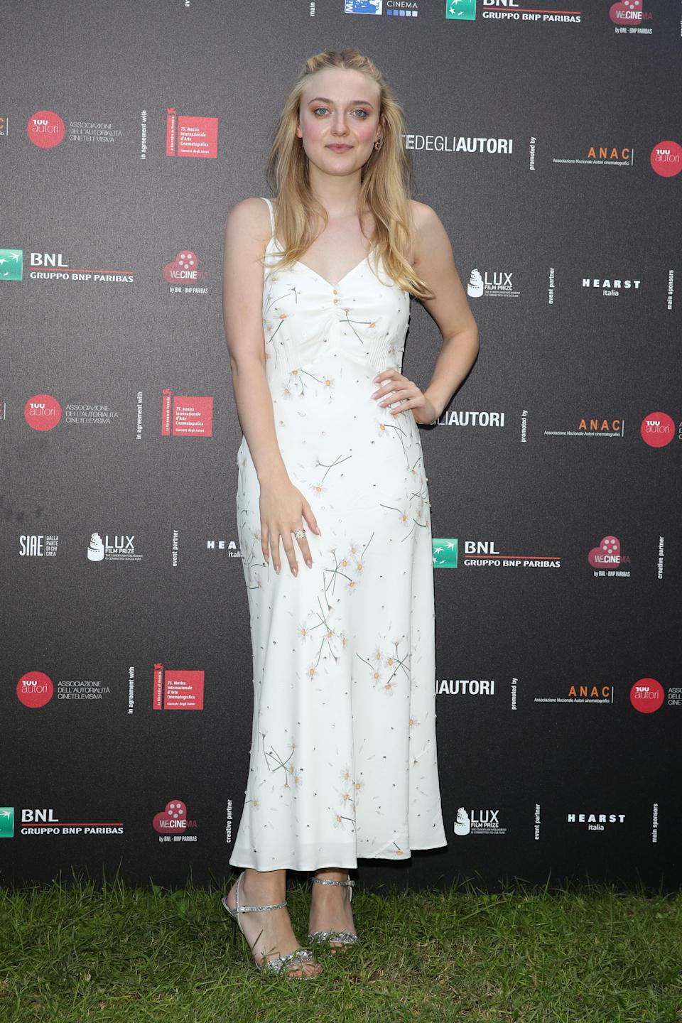<p>A summery, floral Miu Miu dress was the ideal outfit choice for a daytime photocall. <em>[Photo: Getty]</em> </p>