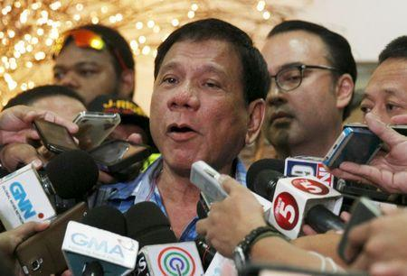 Rodrigo Duterte, 70, seven-term mayor of Davao city, who has built a reputation for fighting crime in the insurgency-plagued southern Philippines, talks to the media, outside the Commission on Elections in Manila, Philippines December 8, 2015. REUTERS/Czar Dancel