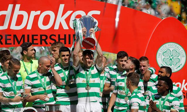 Soccer Football - Scottish Premiership - Celtic vs Aberdeen - Celtic Park, Glasgow, Britain - May 13, 2018 Celtic's Kieran Tierney lifts the trophy with teammates as they celebrate winning the Scottish Premiership REUTERS/Russell Cheyne