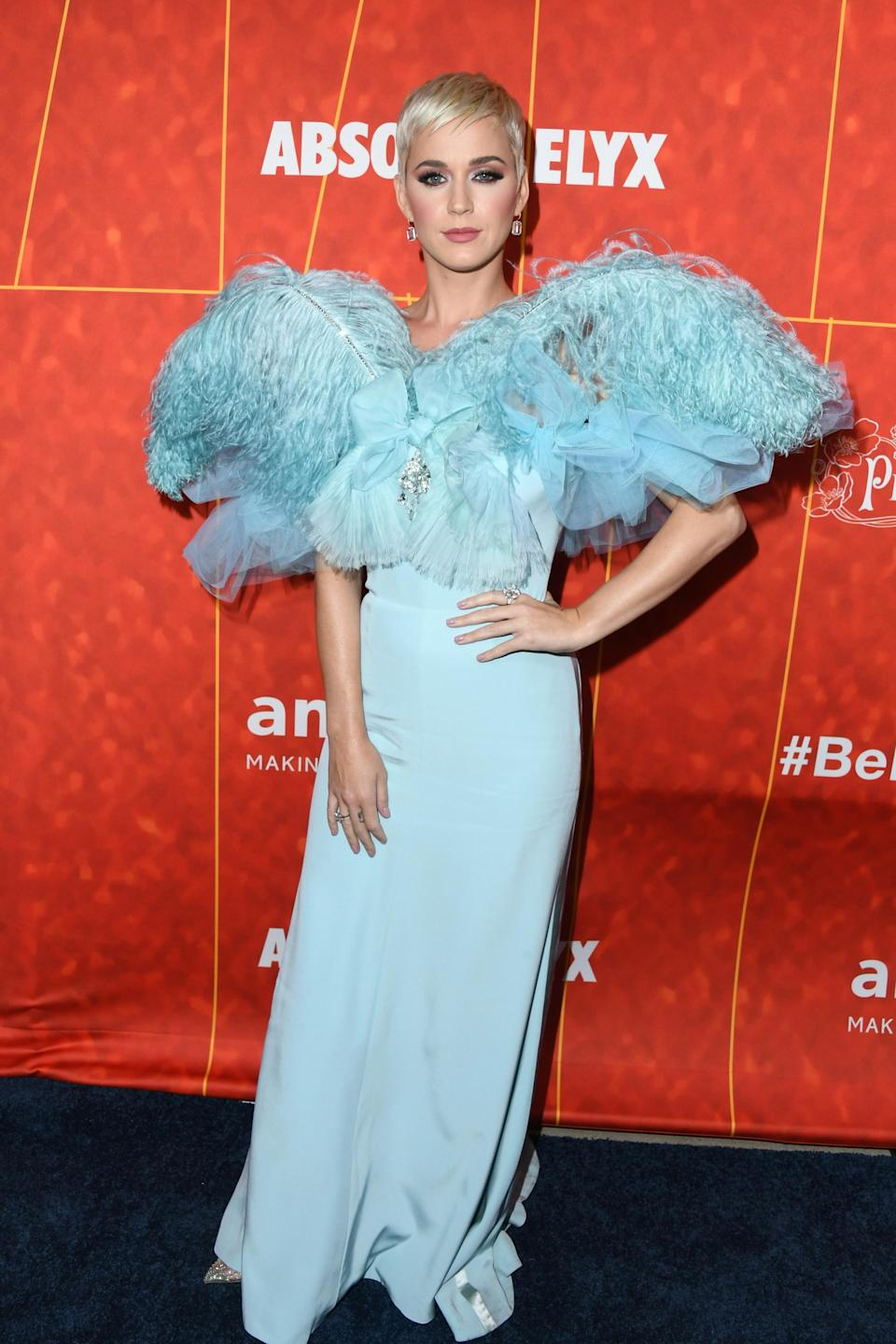 <p>The made an entrance in an icy blue dress, with an extravagant neckline made up of tulle and feathers, in a dress by French fashion house Alexis Mabille. <em>[Photo: Getty]</em> </p>