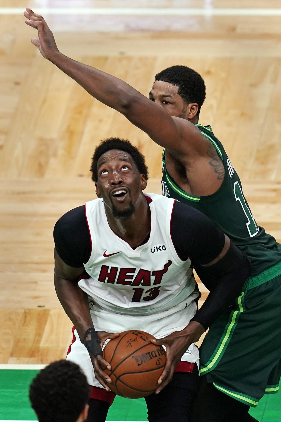 Miami Heat center Bam Adebayo, left, looks to shoot while covered by Boston Celtics center Tristan Thompson during the second half of an NBA basketball game Tuesday, May 11, 2021, in Boston. (AP Photo/Charles Krupa)