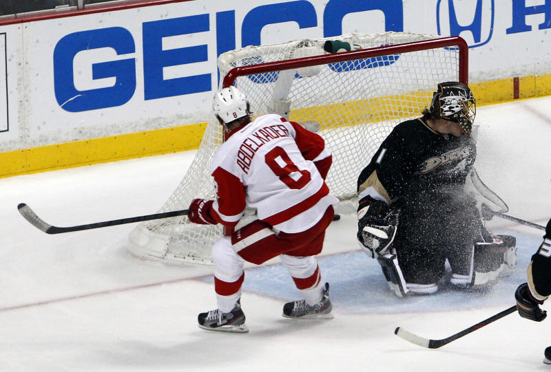 Detroit Red Wings left wing Justin Abdelkader, left, scores on Anaheim Ducks goalie Jonas Hiller during the first period in Game 7 of their first-round NHL hockey Stanley Cup playoff series in Anaheim, Calif., Sunday, May 12, 2013. (AP Photo/Chris Carlson)