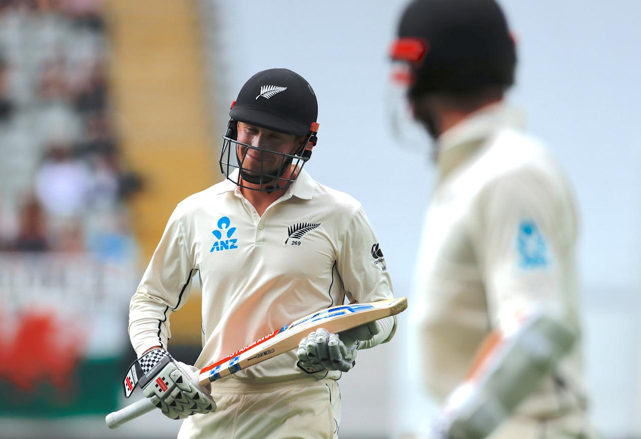 Cricket - Test Match - New Zealand v England - Eden Park, Auckland, New Zealand, March 23, 2018. New Zealand's Henry Nicholls reacts as he applauds team mate and captain Kane Williamson as they walk off the ground during a rain delay on the second day of the first cricket test match.    REUTERS/David Gray