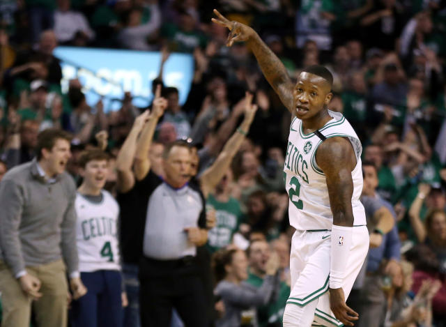 Terry Rozier celebrates one of his seven 3-pointers in the Celtics' Game 1 rout of the visiting 76ers to open the Eastern Conference semifinals. (AP)
