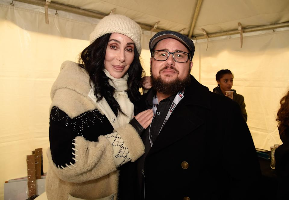 WASHINGTON, DC - JANUARY 21:  Cher (L) and Chaz Bono attend the rally at the Women's March on Washington on January 21, 2017 in Washington, DC.  (Photo by Kevin Mazur/WireImage)