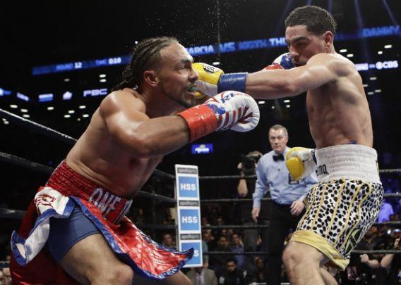 Keith Thurman, left, fights Danny Garcia during the 12th round of a welterweight championship boxing match Saturday, March 4, 2017, in New York. Thurman won the fight. (AP Photo/Frank Franklin II)
