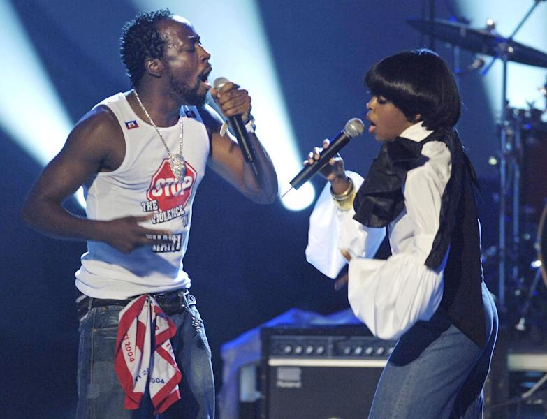 """FILE - This June 28, 2005 file photo shows Wyclef Jean, left, and Lauryn Hill performing during the 5th annual BET Awards in Los Angeles. Jean has written an autobiography, """"Purpose,"""" on sale Tuesday, Sept. 18, 2012. (AP Photo/Chris Pizzello, file)"""
