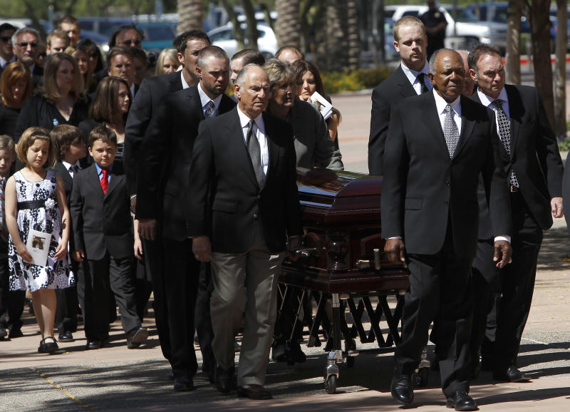 From left to right, pall bearers, current Minnesota Twins players Joe Nathan, Michael Cuddyer, former teammate Frank Quilici, current Twins player Justin Morneau, former teammate Tony Oliva, and Paul Molitor, lead the casket of baseball great Harmon Killebrew prior to the funeral services Friday, May 20, 2011, in Peoria, Ariz. (AP Photo/Ross D. Franklin)