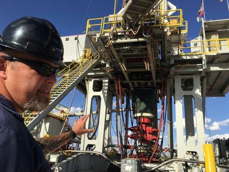 Rig supervisor David Crow shows off the oil rig he manages foreElevation Resources at the Permian Basin drilling site in Andrews County, Texas
