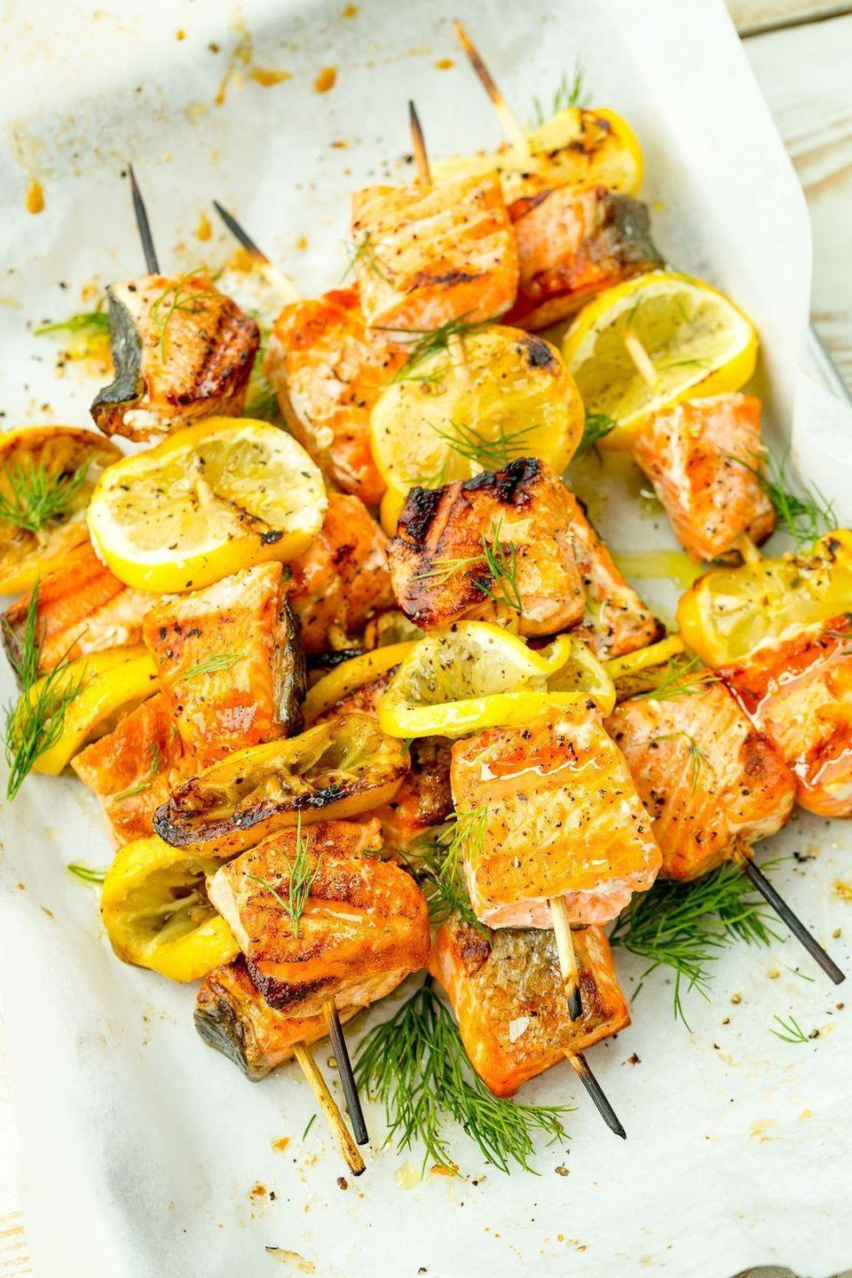 """<p>Lemony salmon kebabs are about to be your go-to for grilling season.</p><p>Get the <a href=""""https://www.delish.com/uk/cooking/recipes/a34615491/mediterranean-salmon-skewers-recipe/"""" rel=""""nofollow noopener"""" target=""""_blank"""" data-ylk=""""slk:Mediterranean Salmon Skewers"""" class=""""link rapid-noclick-resp"""">Mediterranean Salmon Skewers</a> recipe.</p>"""