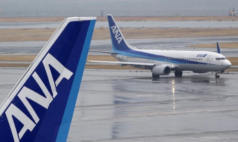 FILE PHOTO: All Nippon Airways' planes are seen at Haneda airport in Tokyo