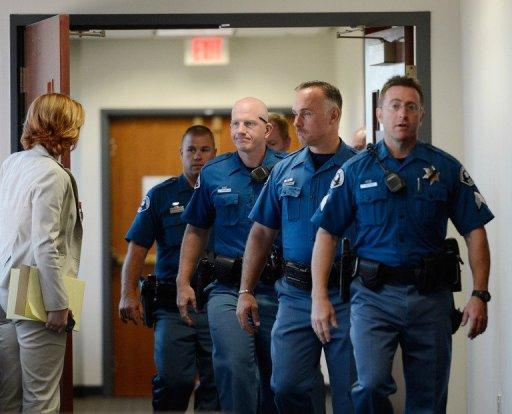 "Arapahoe County Sheriff deputies leave the courtroom after the arraignment of accused theater gunman James Holmes July 30, 2012 in Centennial, Colorado. Holmes was charged with 24 counts of murder and 116 counts of attempted murder in the July 20, shooting rampage at an opening night screening of 'The Dark Knight Rises"" in Aurora, Colorado"