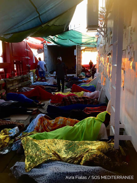 Rescued migrants sleep on the Ocean Viking, operated by SOS Mediterranee and MSF, as they cruise in the Mediterranean Sea, in the early hours of Friday, Aug. 23, 2019. Malta agreed Friday to disembark 356 migrants who were trapped for two weeks on the Ocean Viking, capping a week of standoffs between charities and governments that have exposed in dramatic ways Europe's inability to deal with migration from Africa. (Avra Fialas/SOS Mediterranee via AP)