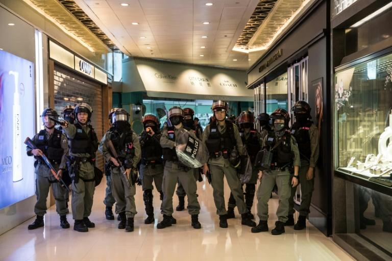 Hong Kong's many malls have become regular protest venues as protesters try to cause economic disruption in their push for greater democratic freedoms and police accountability (AFP Photo/DALE DE LA REY)