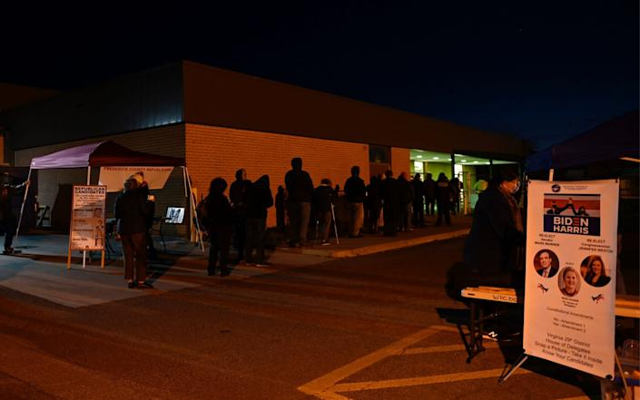 Voters wait in line at a polling station on US Election Day in Winchester, Virginia  - AFP