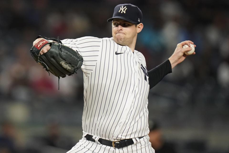 New York Yankees' Jordan Montgomery delivers a pitch during the third inning of a baseball game against the Texas Rangers Tuesday, Sept. 21, 2021, in New York. (AP Photo/Frank Franklin II)