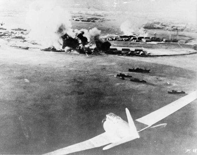 <p>A Japanese bomber aircraft is seen in the foreground of an aerial photograph taken by a Japanese pilot during the attack on Pearl Harbor on Dec. 7, 1941. (U.S. Navy/NEA Services/Handout via Reuters) </p>