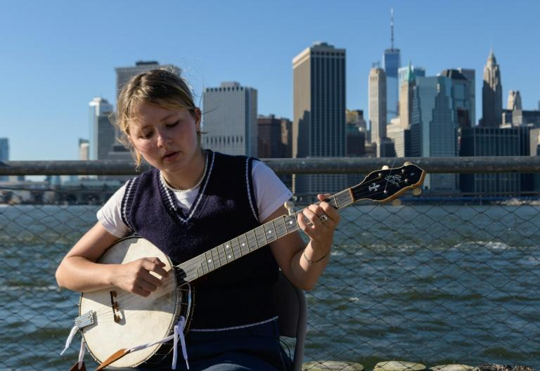 Musician Nora Brown plays her banjo prior to performing at the Brooklyn Americana Music Festival on September 19, 2021, in New York City (AFP/Angela Weiss)