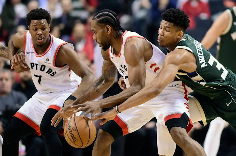 Milwaukee Bucks forward Giannis Antetokounmpo (34) reaches in on Toronto Raptors forward Kawhi Leonard (2) during the first half of Game 4 of the NBA basketball playoffs Eastern Conference finals, Tuesday, May 21, 2019 in Toronto. (Frank Gunn/The Canadian Press via AP)