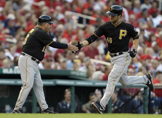 Pittsburgh Pirates' Garrett Jones, right, is congratulated by third base coach Nick Leyva after hitting a solo home run during the second inning of a baseball game against the St. Louis Cardinals Wednesday, Aug. 14, 2013, in St. Louis. (AP Photo/Jeff Roberson)