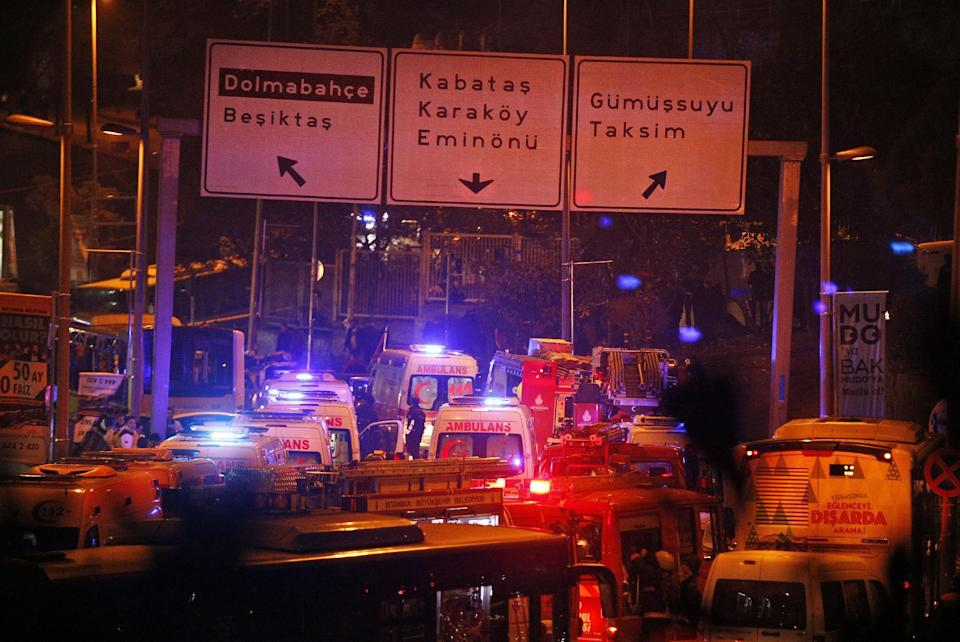 Rescue services rush to the scene of explosions near the Besiktas football club stadium, following at attack in Istanbul, late Saturday, Dec. 10, 2016. Two loud explosions have been heard near the newly built soccer stadium and witnesses at the scene said gunfire could be heard in what appeared to have been an armed attack on police. Turkish authorities have banned distribution of images relating to the Istanbul explosions within Turkey. (AP Photo/Emrah Gurel) TURKEY OUT