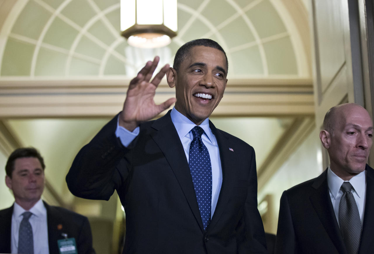 <p>               President Barack Obama, escorted by House Sergeant at Arms Paul Irving, right, waves as he arrives on Capitol Hill in Washington, Wednesday, March 13, 2013, for closed-door talks with House Speaker John Boehner and the House Republican Conference to discuss the budget. (AP Photo/J. Scott Applewhite)