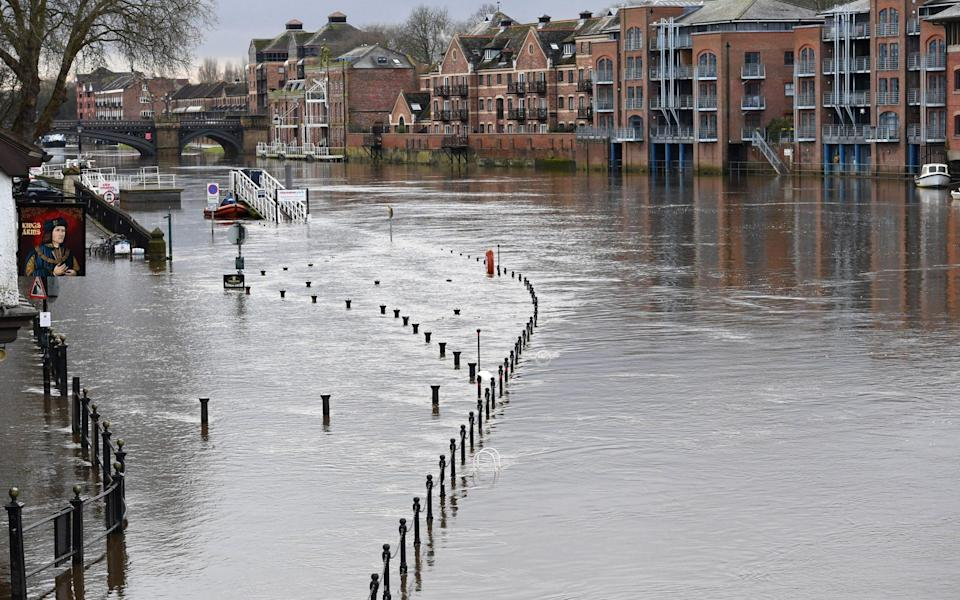 After recent snow and rain the high water level in the River Ouse floods riverside paths in York - Anna Gowthorpe/Shutterstock