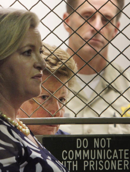 Lois Goodman, center, stands with her attorney, Allison Triessl as her arraignment on murder charges is postponed Friday Aug. 24, 2012, in Los Angeles. Goodman, professional tennis referee, has been accused of murdering her 80-year-old husband. (AP Photo/Nick Ut)