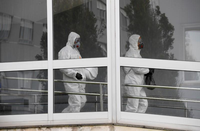 Members of the Military Emergency Unit (UME) take part in a clean-up to prevent the spread of the coronavirus disease (COVID-19) at Cabuenes Hospital in Gijon