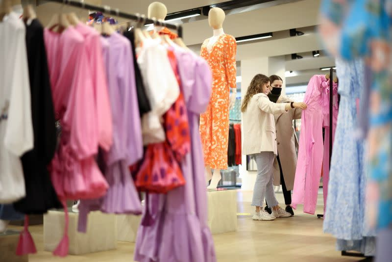 FILE PHOTO: People shop in the Selfridges department store on Oxford street, as the coronavirus disease (COVID-19) restrictions ease, in London