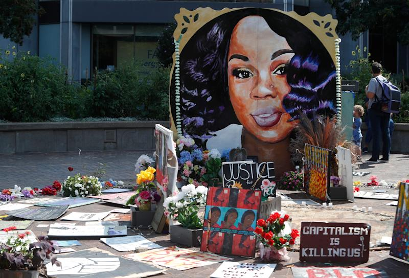 A giant painting of Breonna Taylor as well as many other forms of art are on display at Jefferson Square Park in Louisville.