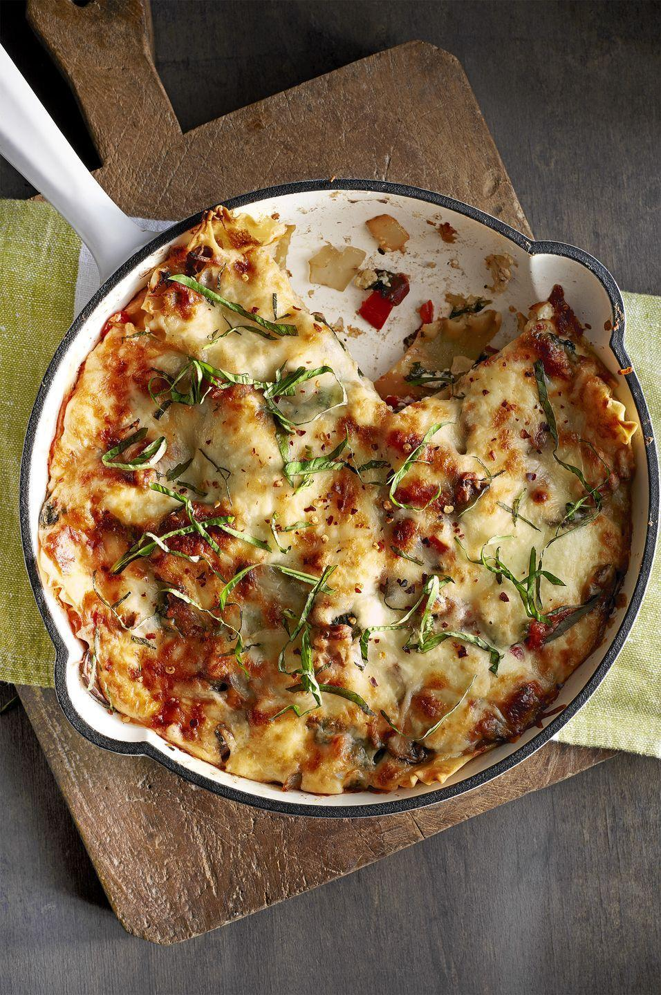 """<p>For cold winter nights, this hearty, meat-free lasagna recipe is the perfect way to warm up.</p><p><strong><a href=""""https://www.countryliving.com/food-drinks/recipes/a343/skillet-mushroom-spinach-lasagna-recipe-clx0215/"""" rel=""""nofollow noopener"""" target=""""_blank"""" data-ylk=""""slk:Get the recipe."""" class=""""link rapid-noclick-resp"""">Get the recipe.</a></strong></p>"""