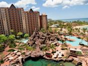 """<p>When it comes to family hotels in Hawaii, <a href=""""https://www.cntraveler.com/hotels/united-states/kapolei/aulani-disney-resort-oahu?mbid=synd_yahoo_rss"""" rel=""""nofollow noopener"""" target=""""_blank"""" data-ylk=""""slk:Disney's Aulani"""" class=""""link rapid-noclick-resp"""">Disney's Aulani</a> resort tops the list. In addition to the requisite pools—of which there are three—and waterslides, this resort offers the most extensive menu of activities, shows, entertainment, and excursions on Oahu. Highlights include the Starlit Hui, a luau-inspired night of Hawaiian entertainment, Disney movie nights under the stars, and storytelling around the Mo'olelo fire pit.</p> <p>Aulani also has one of the island's best kids clubs, known as Aunty's Beach House: A 5,200-square-foot paradise for kids three to 12 years old, with a cinema, arts and crafts room, video game room, and an outdoor play area. For kids 12 and older, there's the Painted Sky Teen Spa—the only one of its kind in Hawaii—which offers massages, manicures, and a body scrub mixology bar. (Parents can sneak into the grown-up Laniwai Spa next door, which boasts 150 spa treatments like the Signature Lomilomi, a Hawaiian massage technique that has been passed down through generations.) Located on the leeward side of Oahu, Aulani is a 40-minute drive from the bustle of Waikiki, where the majority of the island's resorts are located.</p> <p><strong>Book now:</strong> From $521 per night, <a href=""""https://cna.st/affiliate-link/9zNiHPnpHZkjbyBxu7wzMx2MKo89u87i2WbjCKmHBJXhAjsbqSadYjcFgy2UCU7F99WDoe5jpXiTahGgxEsKkHvQWT3n1E8phypVxB6E3eiQuRZkvuJiF7AqyYo1fhCFDR4HAbAYny?cid=5509907b481a91bb7819fefb"""" rel=""""nofollow noopener"""" target=""""_blank"""" data-ylk=""""slk:expedia.com"""" class=""""link rapid-noclick-resp"""">expedia.com</a></p>"""