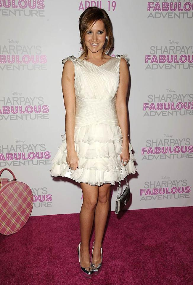 "Former ""High School Musical"" star Ashley Tisdale, 25, toasted the release of her latest project, the straight-to-DVD ""Sharpay's Fabulous Adventure"" with a few familiar faces at Soho House in West Hollywood, California, Wednesday. The belle of the ball wore a Farah Angsana frock and Ben-Amun earrings. Jason LaVeris/<a href=""http://www.filmmagic.com/"" target=""new"">FilmMagic.com</a> - April 6, 2011"