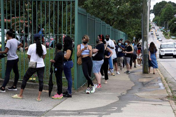 PHOTO: Voters line up outside of a polling location to cast their ballots after Democratic and Republican primaries were delayed due to COVID-19 restrictions in Atlanta, June 9, 2020. (Dustin Chambers/Reuters, FILE)