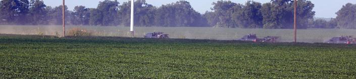 <p>Mississippi wildlife law officers form a caravan as they bring a special response trailer and a number of all terrain vehicles along a county farm road adjacent to U.S. Highway 82, as they head to the wreckage of a military refueling tanker aircraft that crashed Monday in a soybean field near Itta Bena, Miss., on the western edge of Leflore County, Tuesday, July 11, 2007. (Photo: Rogelio V. Solis/AP) </p>