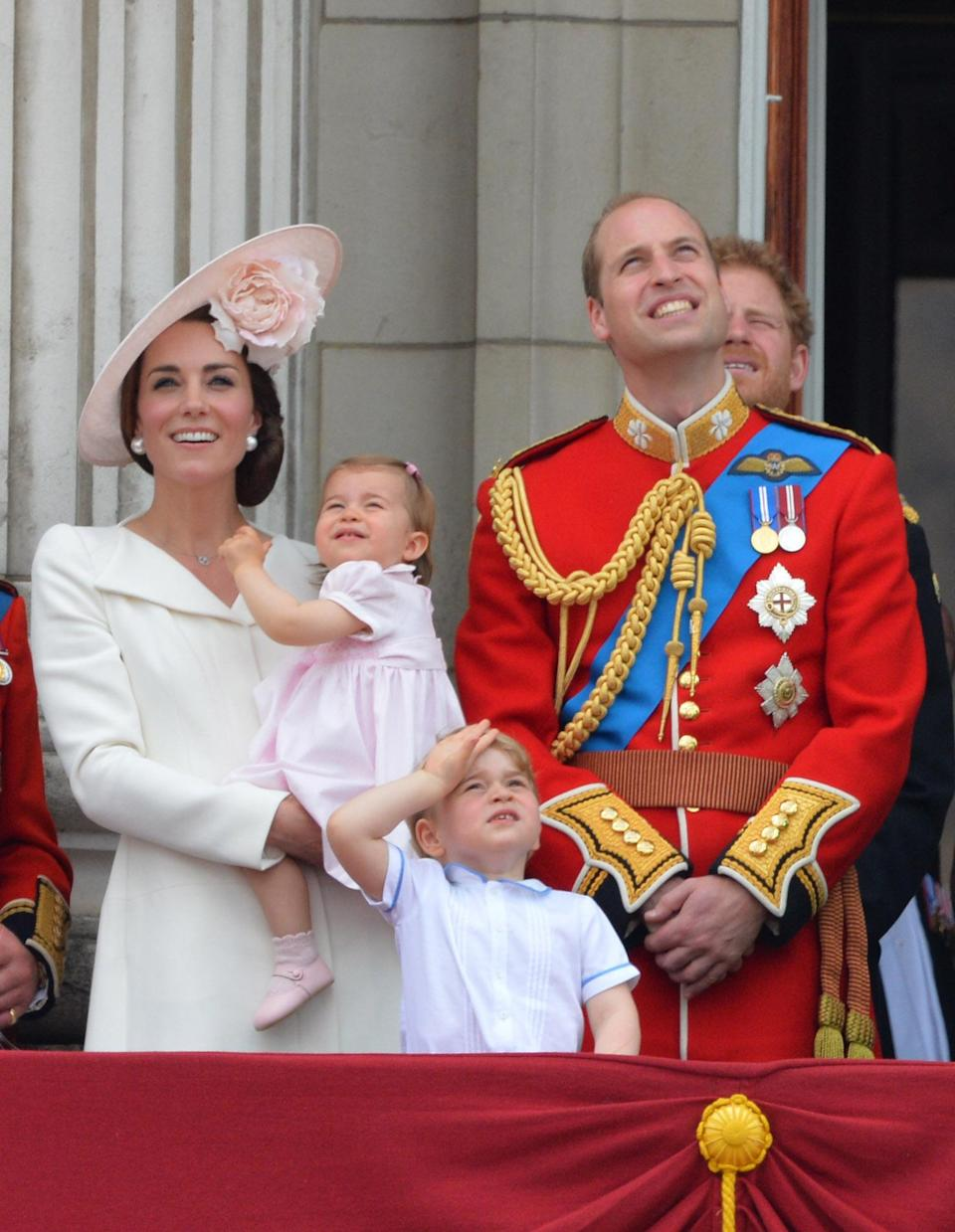 <p>The young royal watches the planes go by at the Queen's 90th birthday celebrations.<br><i>[Photo: PA]</i> </p>