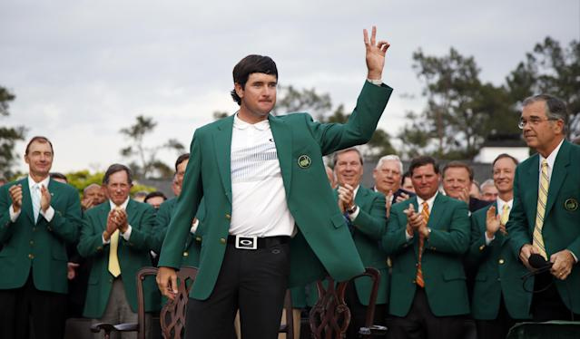 Bubba Watson waves after being presented with his green jacket after winning the Masters golf tournament Sunday, April 13, 2014, in Augusta, Ga. (AP Photo/Matt Slocum)