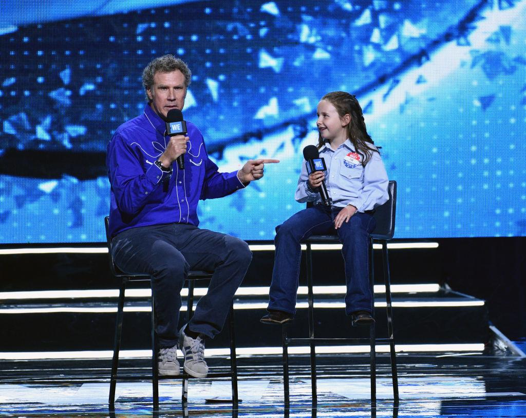 Will Ferrell jokes with presidential expert Macey Hensley at WE Day. (Photo: Allen Berezovsky/FilmMagic)