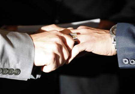 File photo of Katami and Zarrillo exchanging wedding rings in Los Angeles