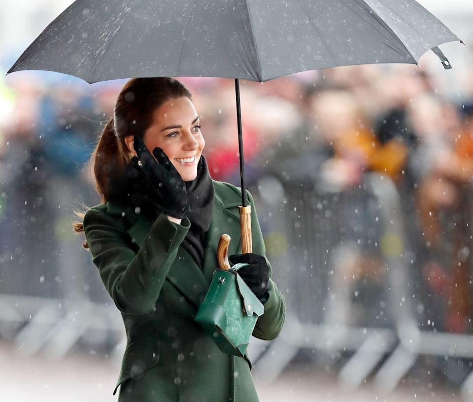 """<p>If anyone knows how to deal with the rain, <a href=""""https://www.townandcountrymag.com/society/tradition/a26899647/queen-elizabeth-umbrellas-fulton-match-outfit/"""" rel=""""nofollow noopener"""" target=""""_blank"""" data-ylk=""""slk:the royal family does"""" class=""""link rapid-noclick-resp"""">the royal family does</a>. Here, the Duchess of Cambridge wields an umbrella like the best of them. </p>"""