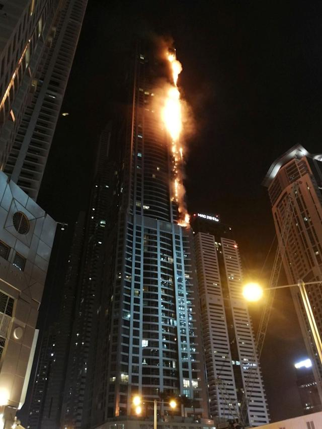 <p>Flames shoot up the sides of the Torch tower residential building in the Marina district, Dubai, U.A.E., Aug. 4, 2017. (Photo: Mitch Williams/Social Media Website/via Reuters) </p>