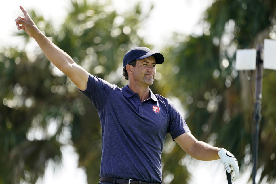 Adam Scott of Australia gestures after he hits from the fourth tee during the first round of the Honda Classic golf tournament, Thursday, March 18, 2021, in Palm Beach Gardens, Fla. (AP Photo/Marta Lavandier)